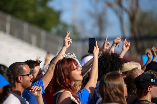 A member of the audience holds up a peace sign while waiting for presidential candidate Bernie Sanders to begin his rally at Bonney Field in Sacramento, California on May 9, 2016. (Photo by Kyle Elsasser)