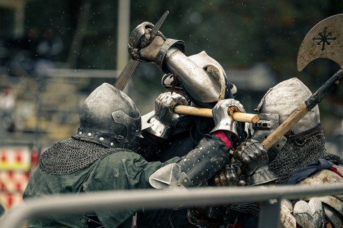 "Members of the North West region ""WolfPack"" battle with members of the USA Knights. The USA Knights are the American national team that competes in  the International Medieval Combat Federation. (Photo by Kyle Elsasser)"