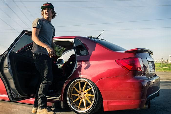 Kodi Nelson works on his 2009 Subaru Impreza WRX on Feb. 23 2016. (Photo by Kyle Elsasser)