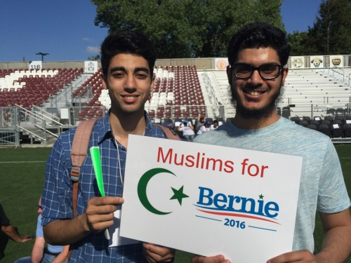 American River College students Omar Mahmi (left) and Tulaib Zafir (right) hold up a 'Muslims for Bernie' sign at the Bernie Sanders in Sacramento. Zafir said, 'Bernie is our only hope.' (Photo by Jordan Schauberger)