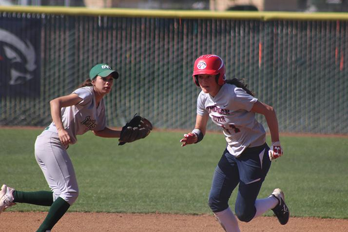 American River College centerfielder Stephanie Scott runs past Diablo Valley shortstop Reyna Sherbourne during a game April 23, 2016 at ARC. ARC won 7-6. (Photo by Mack Ervin III)