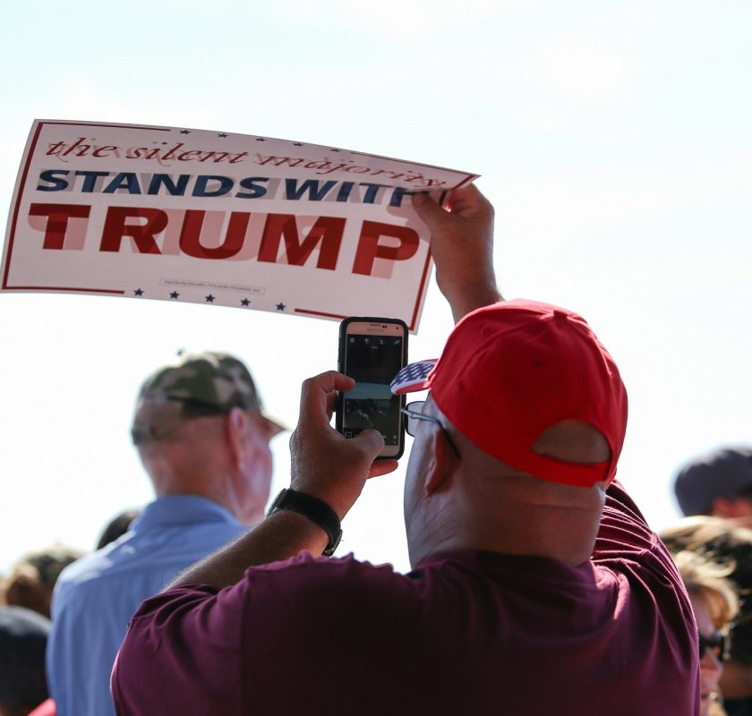 An audience member takes a picture at Donald Trump's rally in Sacramento, California on June 1, 2016. (Photo by Kyle Elsasser)
