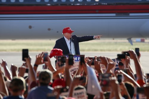 Presumptive GOP nominee Donald Trump points to members of the audience during his rally in Sacramento, California on June 1, 2016. (Photo by Kyle Elsasser)