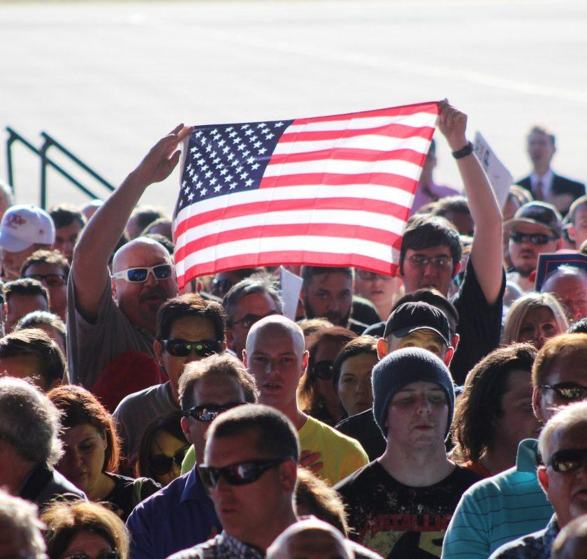 Supporters of Donald Trump hold up an American flag during the recital of the pledge of allegiance at a campaign event in Sacramento, California on June 1, 2016. Trump's first visit to the California capital drew nearly 5,000 supporters. (Photo by Mack Ervin III)