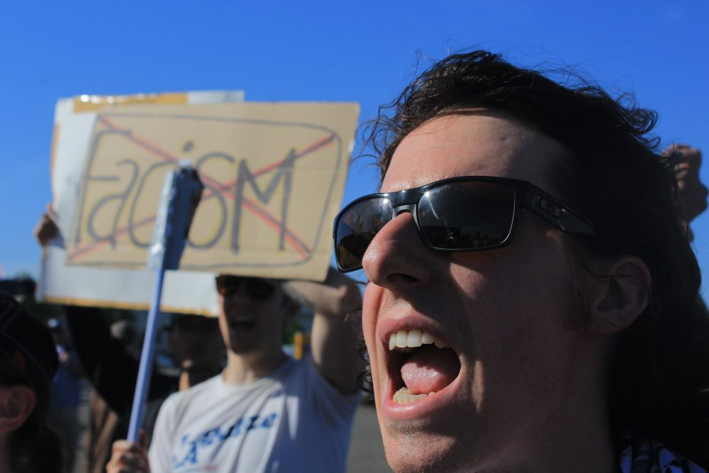 Protester Evan Sandlin shouts at Donald Trump supporters as they file into the presidential hopeful's rally in Sacramento. (Photo by Jordan Schauberger)