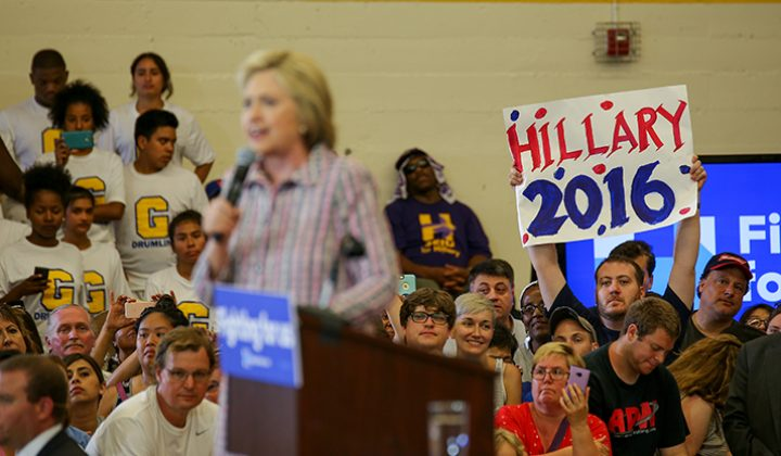 "A Hillary Clinton supporter holds a sign that reads ""Hillary 2016"" during Clinton's campaign event at Sacramento City College in Sacramento, California on June 5, 2016. (Photo by Kyle Elsasser)"