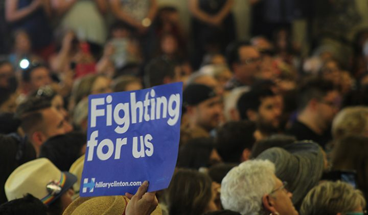 "A supporter of democratic presidential candidate Hillary Clinton hold up a sign during Clinton's speech at Sacraento City College on June 5, 2016. ""Fighting for us"" is Clinton's campaigns slogan. (Photo by Mack Ervin III)"