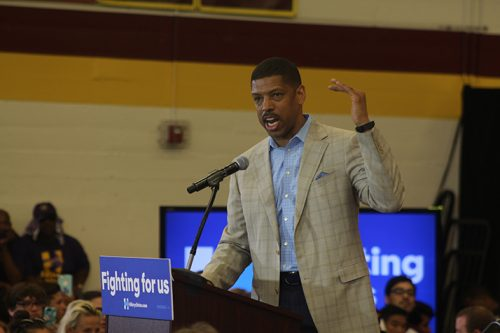 Sacramento mayor Kevin Johnson speaks at a campaign event for Hillary Clinton at Sacramento City College on June 5, 2016. Johnson recieved audible boos from the audience as he took the podium. (Photo by Mack Ervin III)