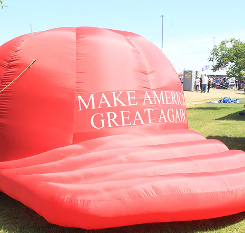 "A giant inflatable hat reading ""Make America Great Again"" is set up outise of a Donald Trump rally in Sacramento, California on June 1, 2016. (Photo by Jordan Schauberger)"