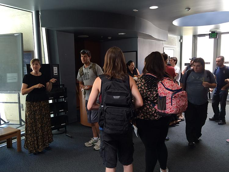 American River College theater professor Tracy Shearer speaks with students in the lobby of the ARC Theatre on Aug. 25, 2016. The theater department hosted a gathering welcoming students back for the year. (Photo by Hannah Darden)