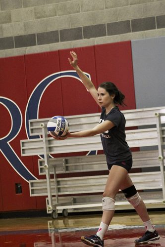 American River College's Emily Dzubak prepares to serve a ball during a women's volleyball practice on Aug. 25, 2016 at ARC. Dzubak was awarded all-conference honors during the 2015 season. (Photo by Mack Ervin III)