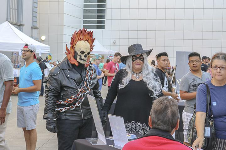 Two cosplayers visit one of the many booths at Artmix at the Crocker Art Museum in Sacramento, California on Sept. 8 (Photo by Luis Gael Jimenez)