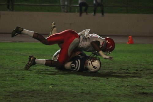 American River College quarterback Griffin Dahn is sacked by City College of San Fransisco defensive back Bobo Leota during a game on Sept. 17 at ARC. Dahn finished 11-28 with 173 yards during the 51-36 loss. (Photo by Mack Ervin III)