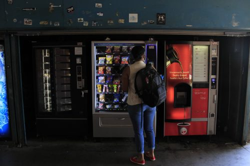 A student passes by a bank if vending machines on ARC's campus on September 12, 2016. (Photo by Jared Smith)