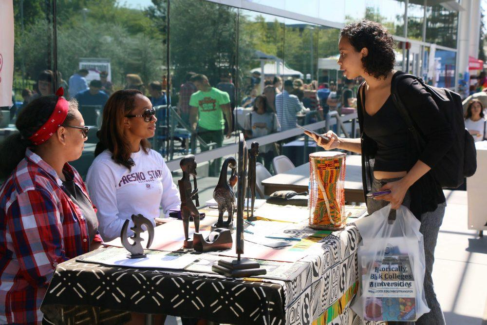 Student Tasiya Owens speaks to Umoja-Sakhu learning community member Nia Simien and counselor Reyna Moore during Club Day at ARC. Sept. 22. (Photo by Laodicea Broadway)
