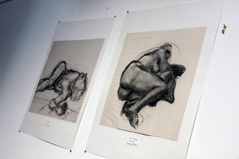 "Alexandrea Villareal's ""Steve Recling"" and ""Curling Monique"" drawings were showed on September 7. The drawings presented here were photographed September 1 to show an example of Villareal's work for the Kaneko Gallery's ""The Shadow Box"" event. (Photo Mychael Jones)"