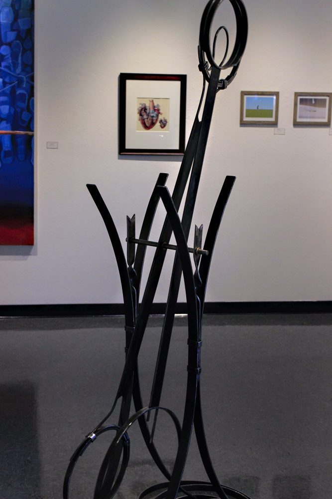 """""""Solemente"""" by Laura Parker on display at the James Kaneko Gallery at American River College in Sacramento, California on Sept. 1, 2016. The gallery held a reception for the annual faculty art show. (Photo by Jared Smith)"""