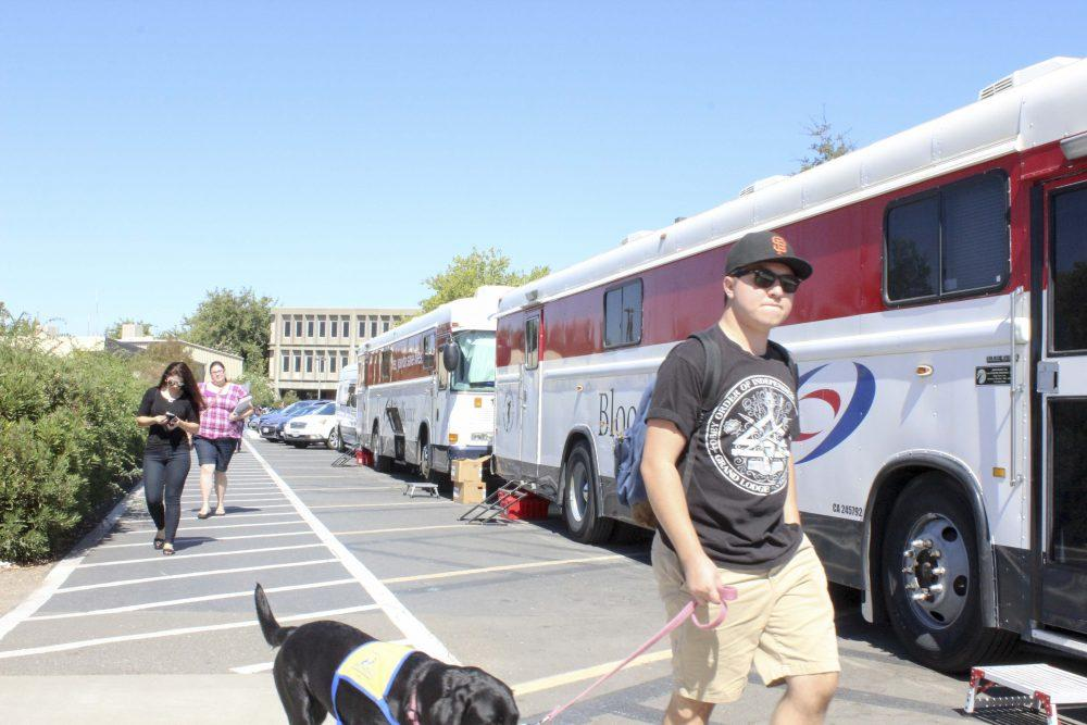 Students walk by the BloodSource blood drive at American River College on Sept. 20. (Photo by Jordan Schauberger)