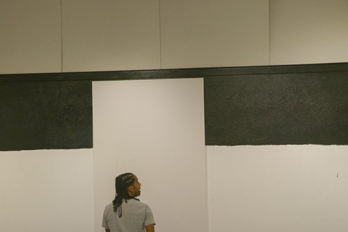 Unity Lewis planning out his artwork in the Kaneko Gallery