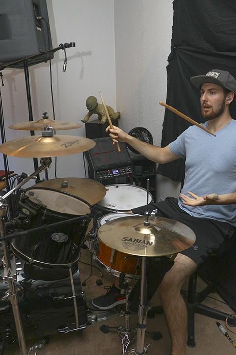 Matt Lomas spinning his drumstick mid-song during a practice session for the band Lucid in Sacramento, California. (Photo by Luis Gael Jimenez)