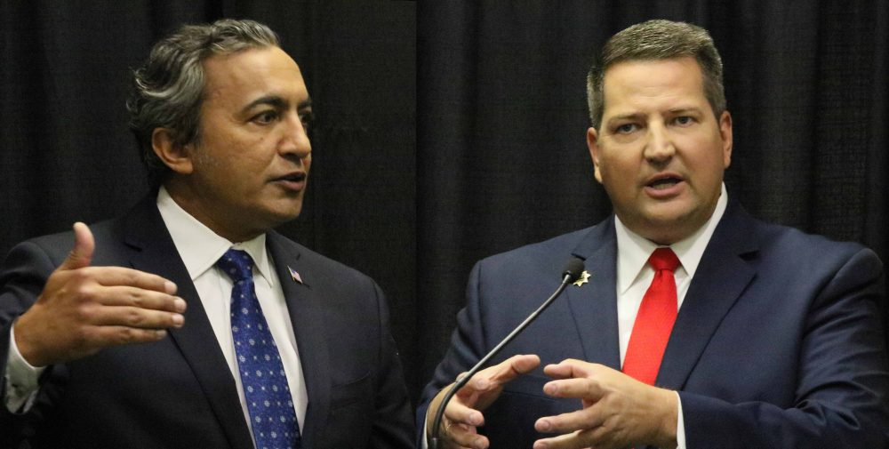 Congressman+Ami+Bera+%28left%29+and+Sheriff+Scott+Jones+%28right%29+answer+questions+during+press+conferences+following+their+7th+Congressional+District+debate+on+Tuesday.+%28Photo+by+Jordan+Schauberger%29