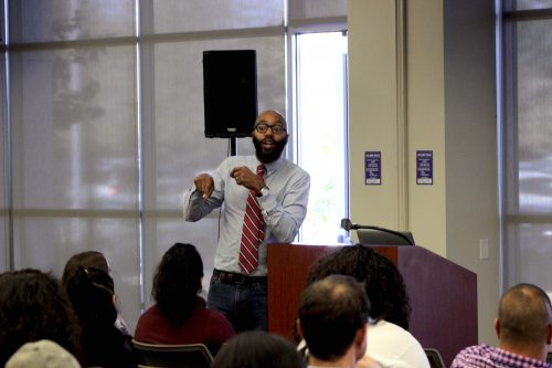 Dr. Christopher Emdin speaking about Science, Technology, Engineering, Mathematics (STEM), and Hip-Hop fusion in the community rooms, Thursday, Oct. 20. Many students showed up to listen to Dr. Emdin relate learning to Hip-Hop culture.