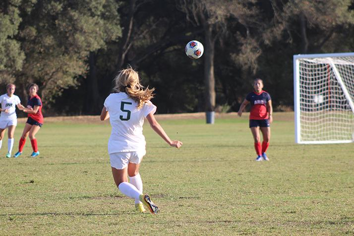Diablo Valley College defender Zoe Ramer crosses the ball into the box from a free kick during a game against American River College on Oct. 7, 2016 at ARC. ARC lost 3-0. (Photo by Mack Ervin III)