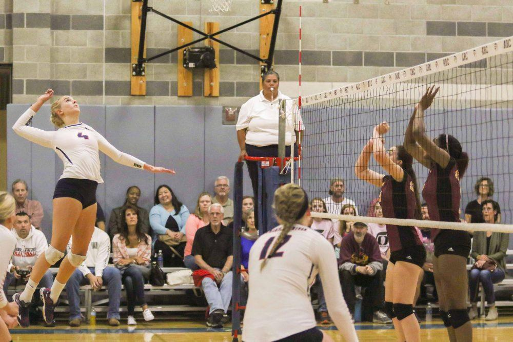 Outside Hitter Dani Schoen gets ready to spike the ball during the Dig Pink game against Sacramento City College on Oct. 19. Arc lost 3-1. (Photo by Laodicea Broadway)