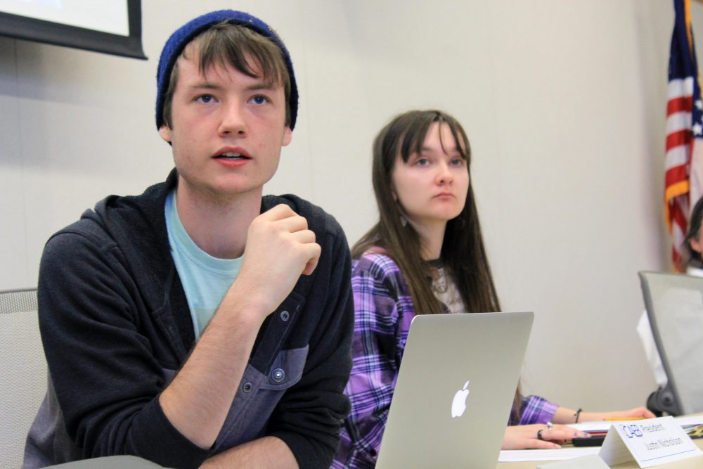 Clubs and Events Board President Justin Nicholson (left) with vice president Mary Stedman (right) listen to the board discuss the theme for next semesters Murder Mystery Dinner at the Oct.11 meeting.  (Photo by Robert Hansen)