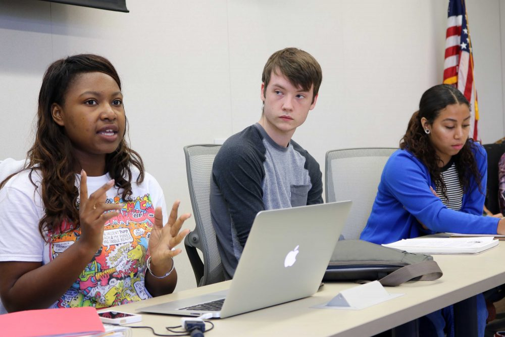 American River Coleege student Senate president Valencia Scott (left) with Justin Nicholson (center) and Alejandra Hilbert (right) gives hear opening message at the October 6, 2016 meeting. (Photo by Robert Hansen)