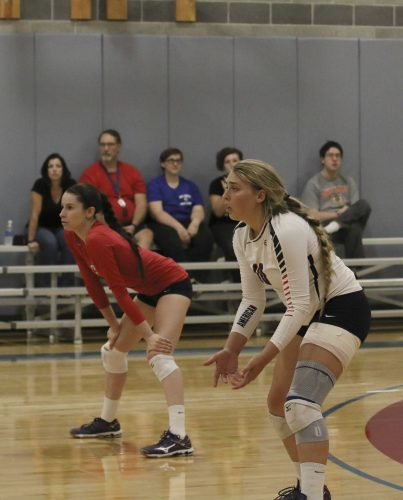 Defensive Specialist Emily Dzubak and Outside Hitter Kaitlin Meyer stand in a ready position during the game against MJC on Sept. 28, Arc won 3 sets to 0. (Photo by Laodicea Broadway)