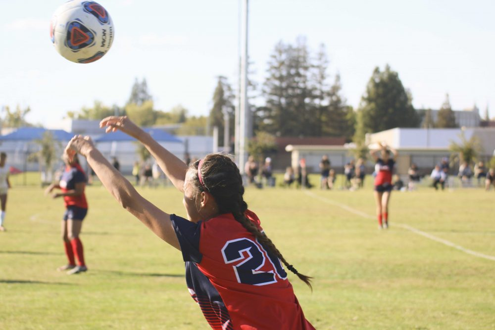 Freshman Player Mikayla Vang throws the ball into play during the soccer game against San Joaquin Delta College on Oct. 4. ARC lost 0-1. (Photo by Laodicea Broadway)