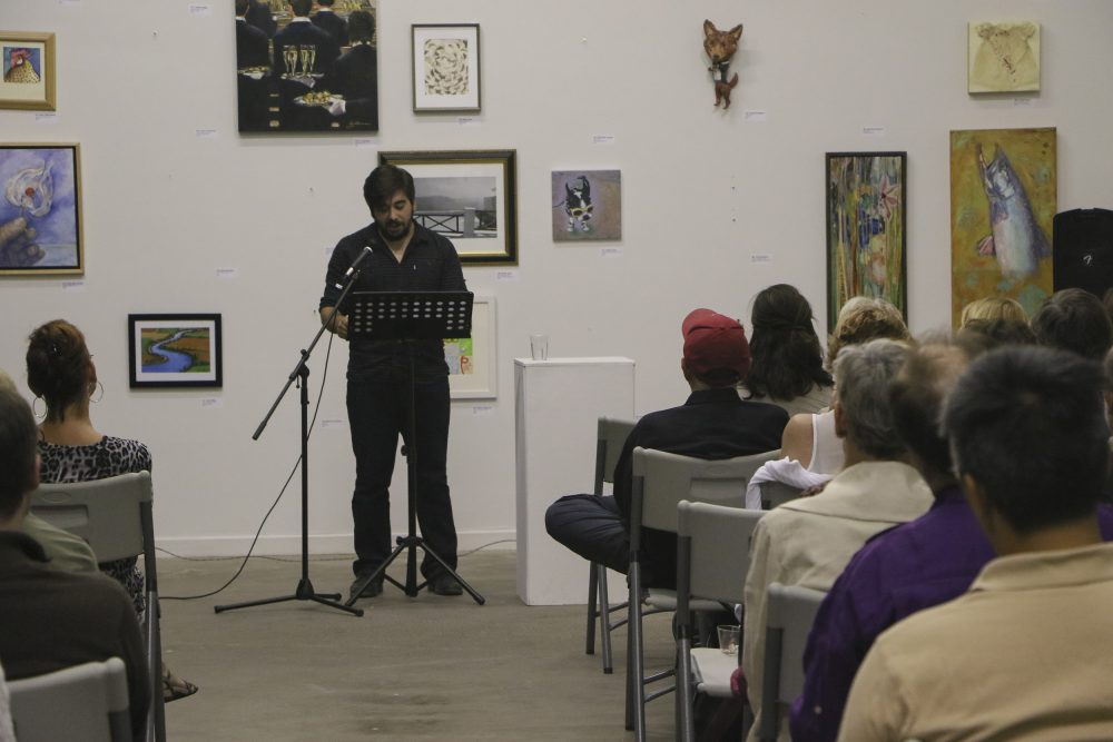 "Local actor Pano Roditis reads from Rachel Gardner's ""Tradesman"" at the Stories on Stage Los Rios night event on Sept. 30, 2016. The event honored the Los Rios creative writing programs with live readings of stories from each college's literary magazine. (Photo by Hannah Darden)"