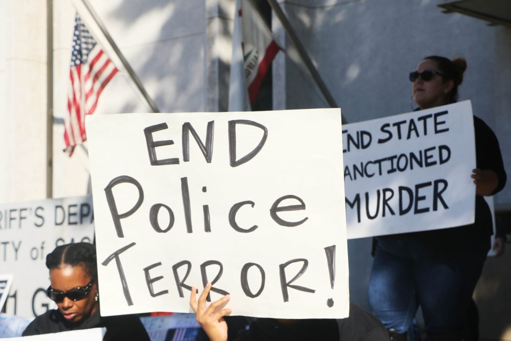 Black Lives Matter protesters stand outside of the Sacramento Sheriff's Department on Nov. 3. They were protest the failure to indict any of the officers involved in the killing of Andriene Ludd and the congress campaign of Sheriff Scott Jones. (Photo by Jordan Schuaberger)
