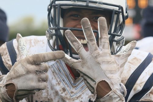 American River College wide receiver Jabarri Johnson screams and points to his ring finger after the team's victory in the NorCal Championship game against Butte College on Nov. 26, 2016 at Butte. The 16-9 victory earned ARC its first ever NorCal title and a chance to play in the State championship game against Fullerton. (Photo by Jordan Schauberger)