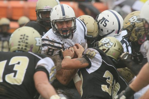 American River College quarterback Griffin Dahn is wrapped up by several Butte College defenders during the NorCal Championship game on Nov. 26, 2016 at Butte College. ARC overcame a 9-0 deficit by scoring 15 unanswered points in the fourth quarter to win the game 15-9 and their first ever NorCal title. (Photo by Jordan Schauberger)