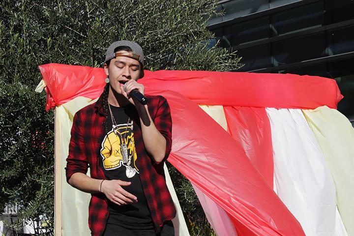 Indigenous hip hop artist Frank Waln performs in the quad at ARC. Waln sang alongside flute player Sam Sampson and choreographer Micco Sampson. (Photo by Cheyenne Drury)