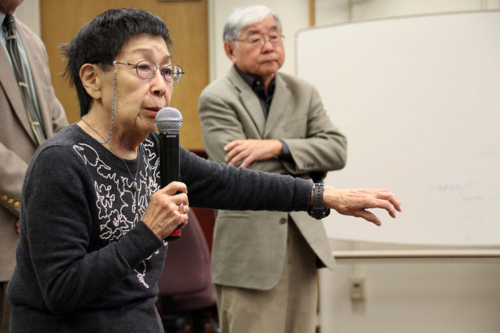 Reiko Nagumo (left) speaks about her experience living in Japanese internment camps during WWII with Lester Ouchida (right) to ARC students in Reaf 160 on Nov. 22, 2016. (Photo by Robert Hansen)