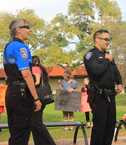 Campuis police maintain the peace at a Trump protest at ARC in front of the Library on Nov. 10. (Photo by Jared Smith)