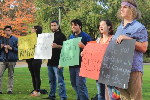 Organizer Julia Stimson (second from right) and other ARC students held a protest against President-elect Donald Trump in front of the ARC Library on Nov. 10. Many students gathered around the protestors, some even argued with the protestors for Trumps side. (Photo by Jared Smith)