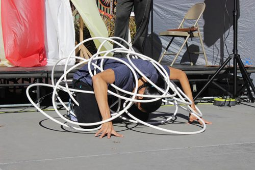 Indigenous choreographer and performer, Micco Sampson, performs at ARC in the quad. He performed hoop dancing, which is a traditional form of dancing that has been passed down in many Native American tribes. (Photo by Cheyenne Drury)