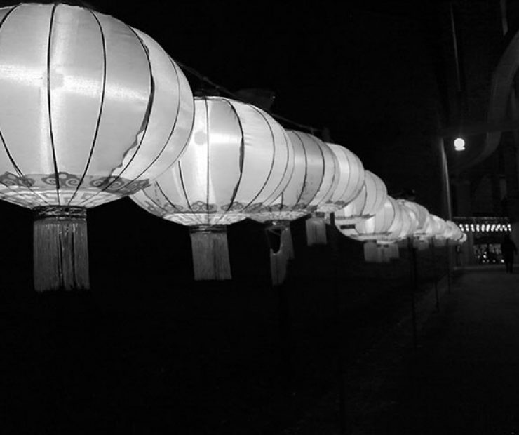 "Lit up  balloons line a walkway at ""Global Winter Wonderland"" at Cal Expo on Sunday in Sacramento, Calif. (Photo by Cheyenne Drury)"