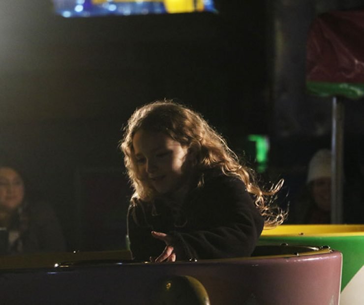 "A girl spins in a teacup ride at ""Global Winter Wonderland"" at Cal Expo on Sunday in Sacramento, Calif. (Photo by Cheyenne Drury)"