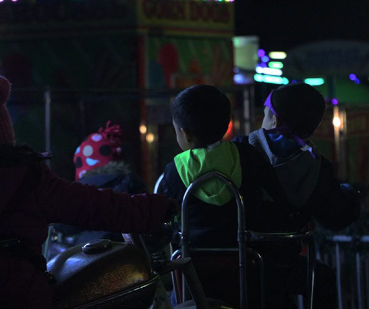"Children ride an amusement ride at ""Global Winter Wonderland"" at Cal Expo on Sunday in Sacramento, Calif. (Photo by Cheyenne Drury)"