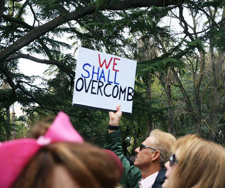 "A man holds up a sign at ""Women's March on Sacramento,"" a nationwide peaceful gathering to show support for all marginalized peoples in downtown Sacramento on Saturday. The event was coordinated by Jessica Browning, Sarah Linder, Annie Adams, and Sita Wilson Stukes. (Photo by Cheyenne Drury)"