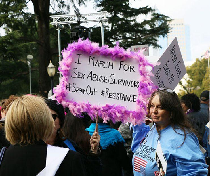 "A women holds up a sign at ""Women's March on Sacramento,"" a nationwide peaceful gathering to show support for all marginalized peoples in downtown Sacramento on Saturday. The event was coordinated by Jessica Browning, Sarah Linder, Annie Adams, and Sita Wilson Stukes. (Photo by Cheyenne Drury)"