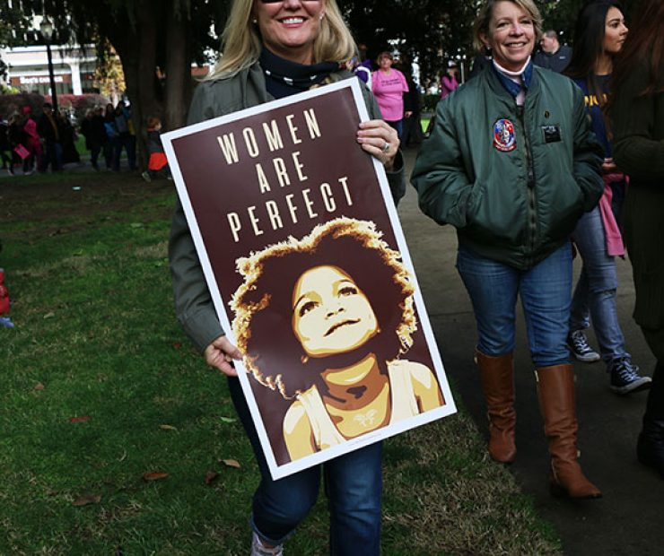 "A womens carries a sign at ""Women's March on Sacramento,"" a nationwide peaceful gathering to show support for all marginalized peoples in downtown Sacramento on Saturday. The event was coordinated by Jessica Browning, Sarah Linder, Annie Adams, and Sita Wilson Stukes. (Photo by Cheyenne Drury)"