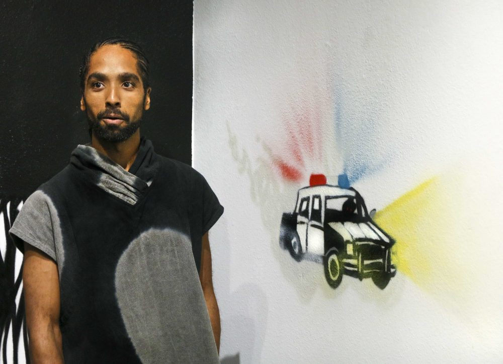 Artist Unity Lewis shares the meaning behind his murals in the Kaneko Gallery at American River College on Oct. 1, 2016. (Photo by Luis Gael Jimenez)