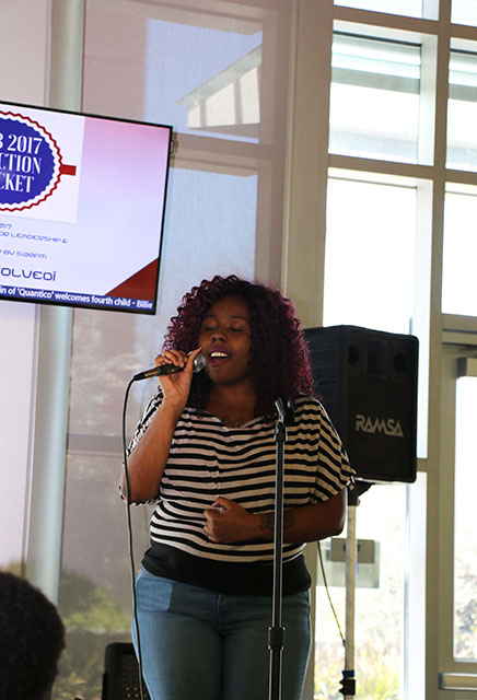 Cheleysa Oliver sings for the Black History Month Celebration Close-Out event inside the Student Center on Feb. 23, 2017. (Photo by John Ennis)