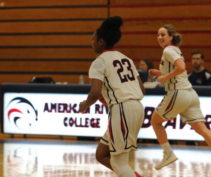 ARC players Alana Myers, a guard, and Jennifer Manduca, a guard, run across the court. (photo gallery by Lidiya Grib)